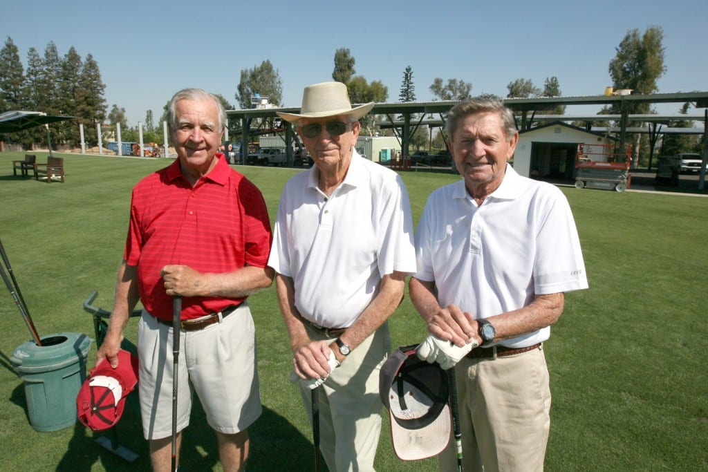 Dan Stockton, Len Bourdet and Bob Fries, all longtime Fort Washington Country Club members, meet at the driving range several times a week. The club's new solar carports (in the background) offer shaded parking while generating power for the club.